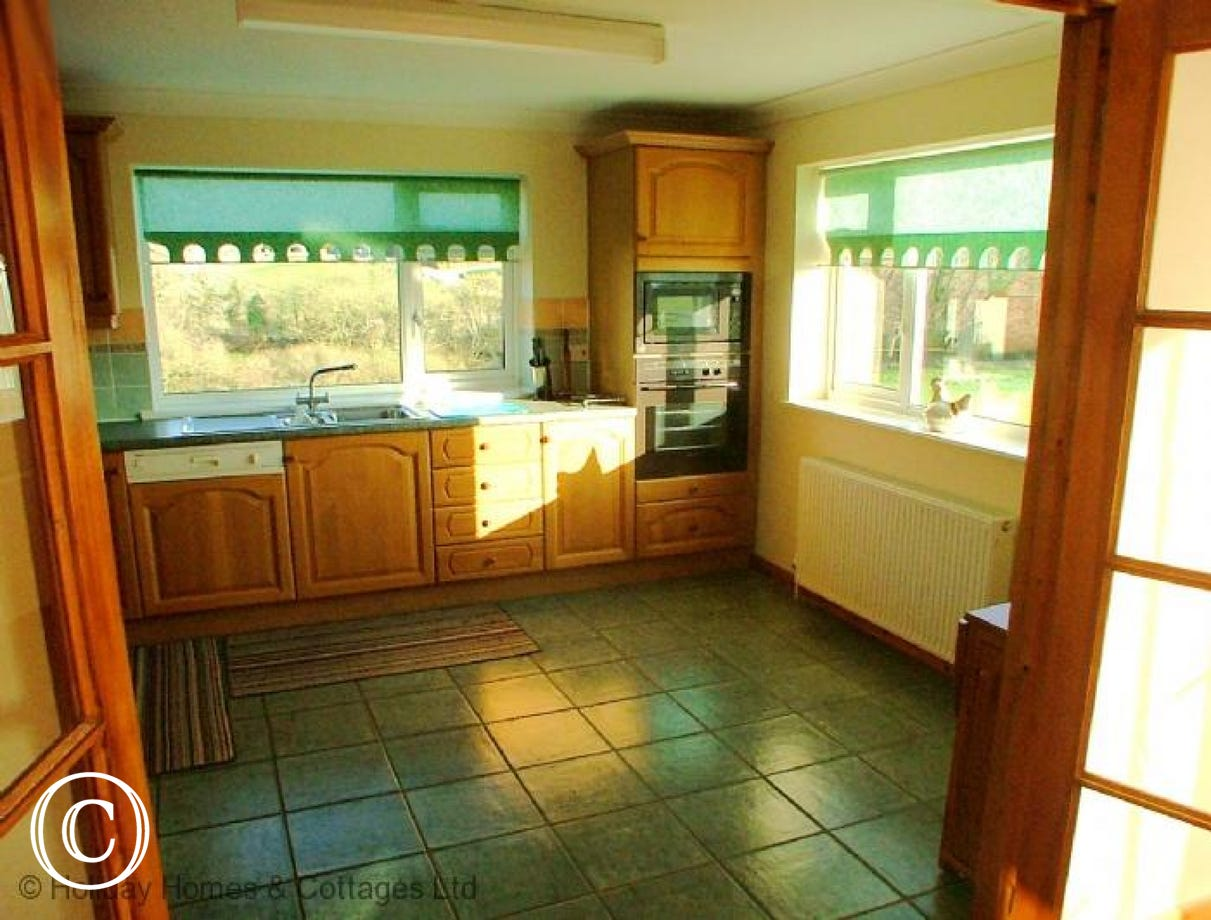 Kitchen: Electric oven, hob, microwave, dishwasher and fridge/freezer.