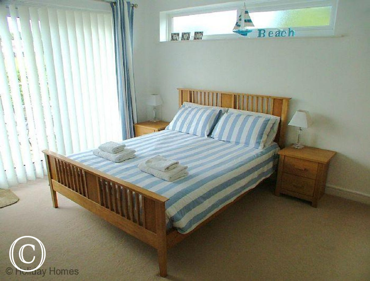 Waves End Torquay - Master Bedroom with doors opening to first floor balcony