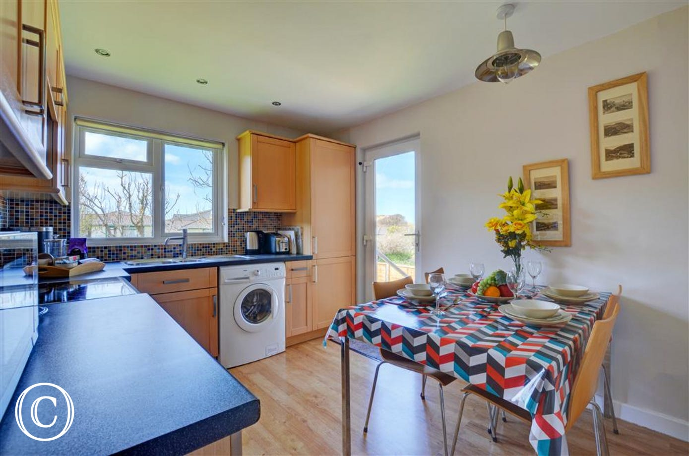 The bright kitchen has a door leading to the south west facing garden