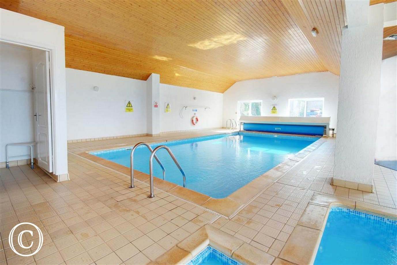 The apartment benefits from a large heated pool and a smaller pool for the children.
