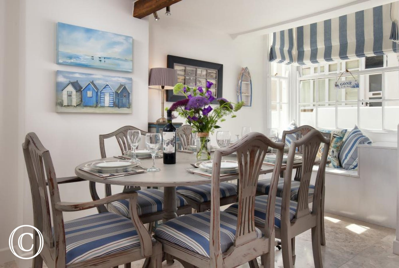 Bright sunny dining area with bay window & seat looking to the front