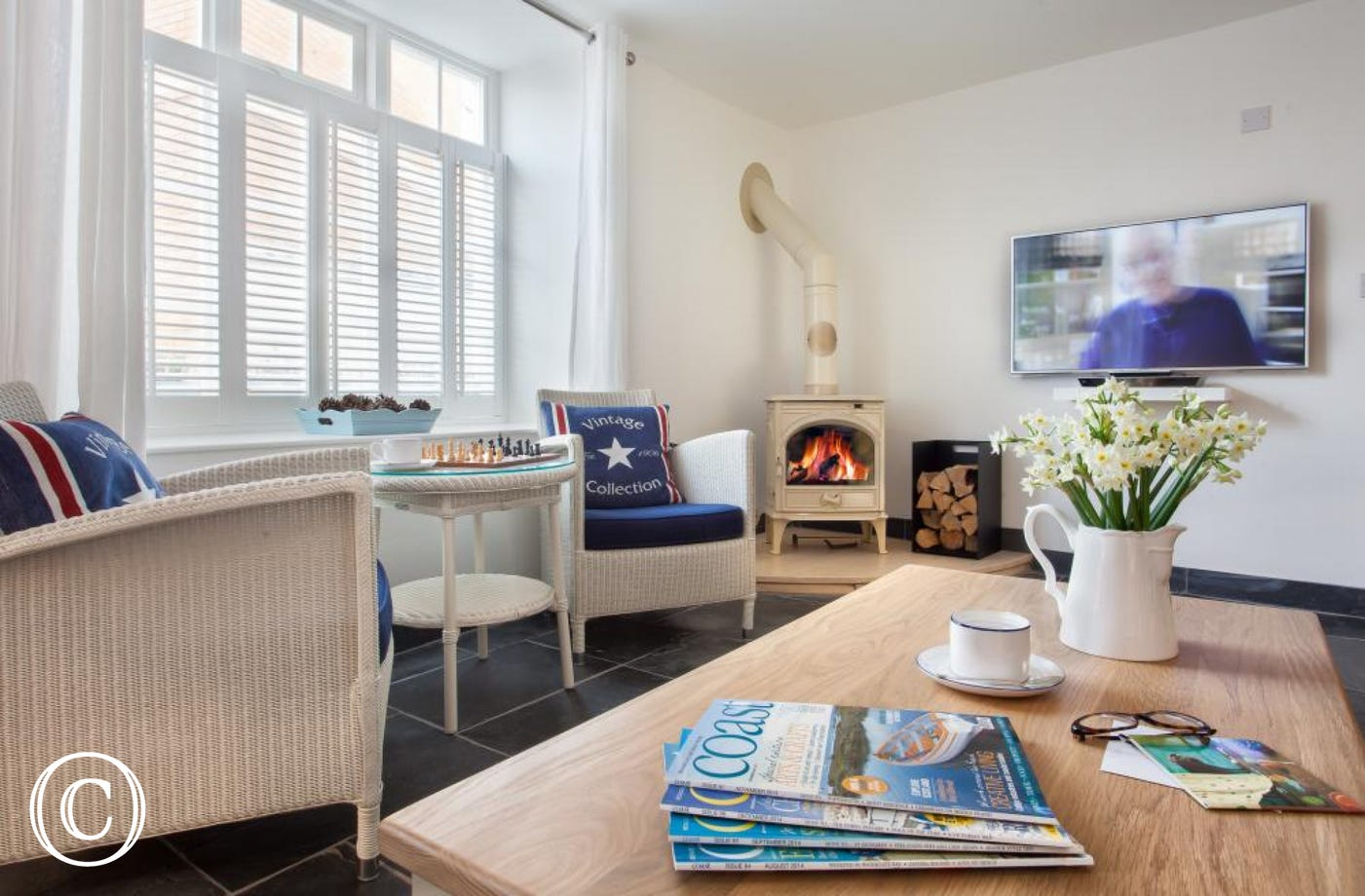 Bright, spacious, cosy lounge accentuated by a wood burning stove & 48