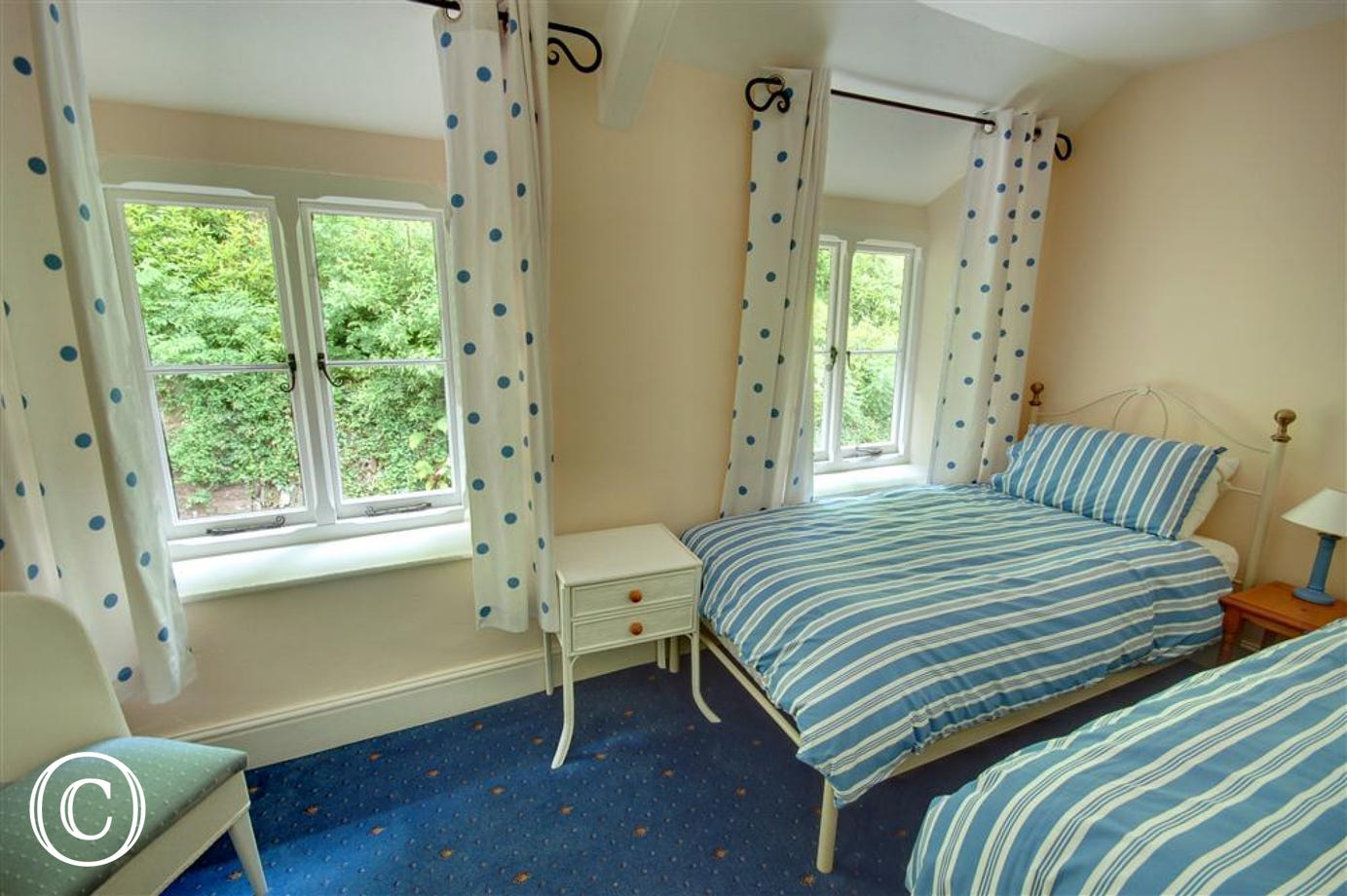 Twin bedroom with two dual aspect windows