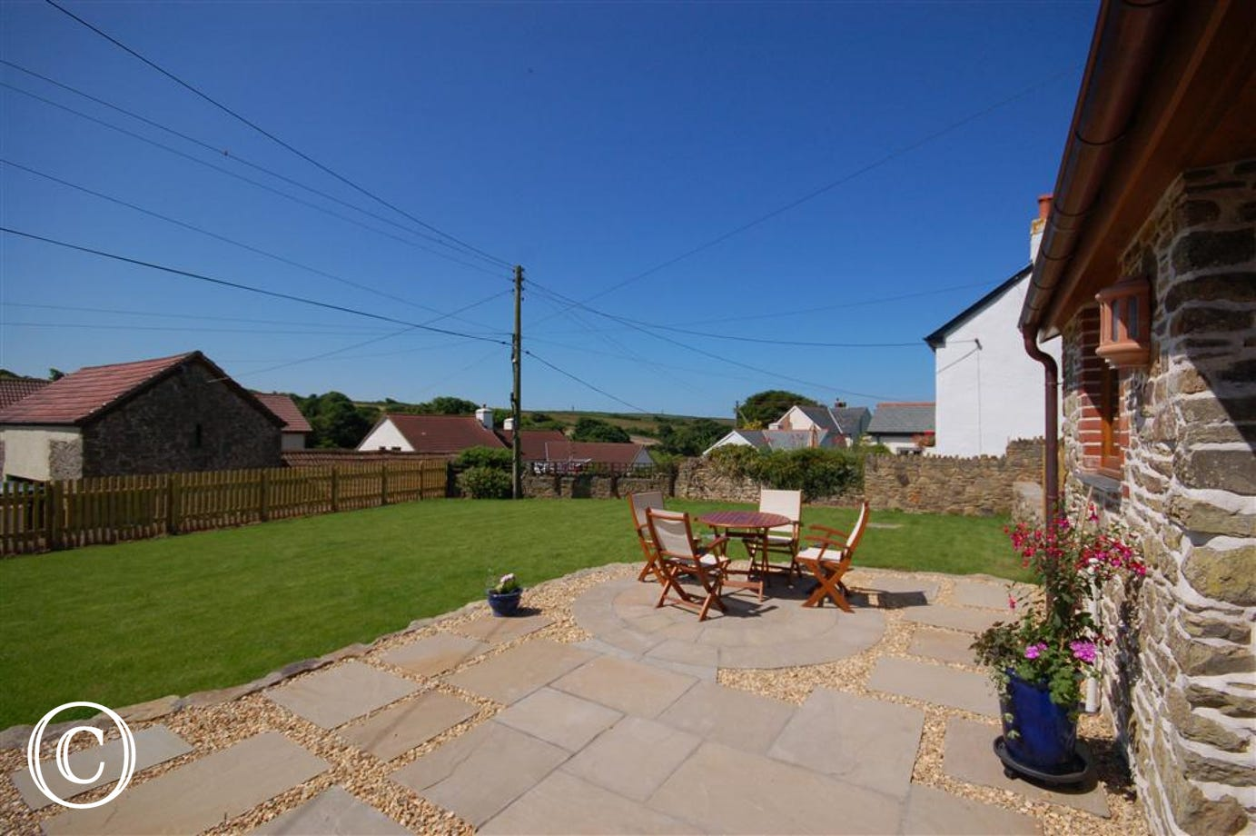 The idyllic enclosed south facing rear garden is a perfect spot to relax and unwind