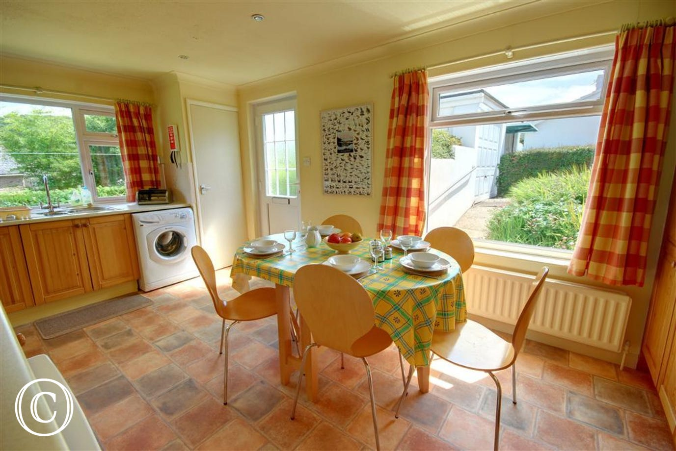 The attractive kitchen/breakfast room has a table and chairs for dining