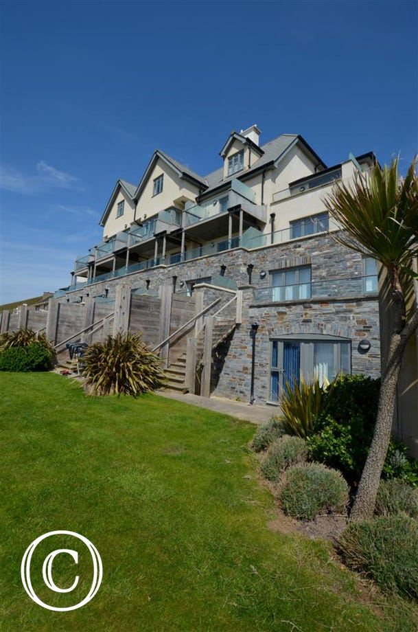 This fabulous duplex garden apartment is located in the most stunning coastal location