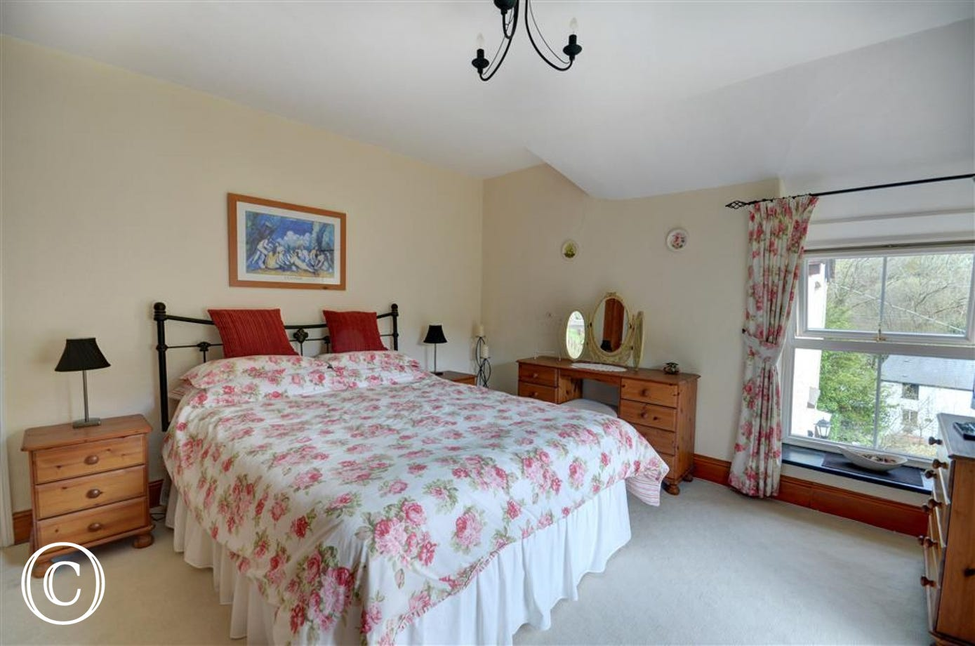 Wake up to delightful countryside views from the spacious bedroom