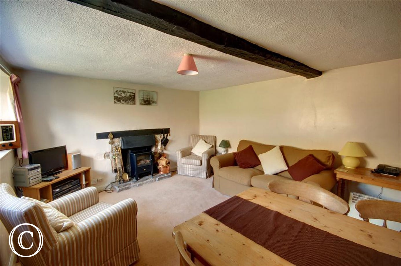 This cosy sitting room still has its orignal beams.