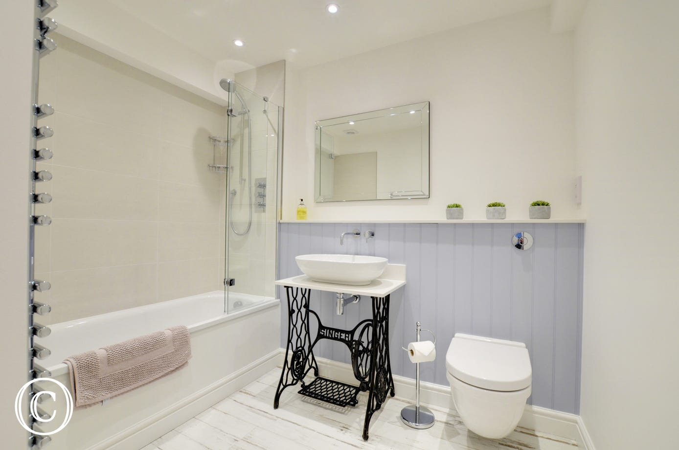The stylish family bathroom with shower over bath