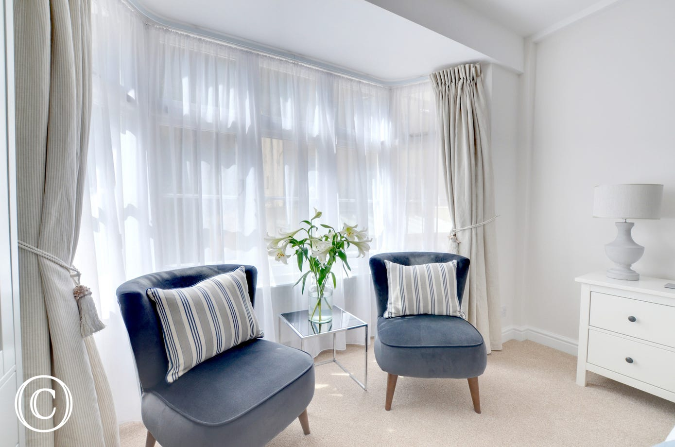 Comfortable seating in the beautiful master bedroom