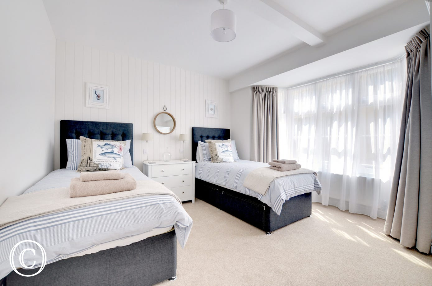 Bright and airy twin bedroom