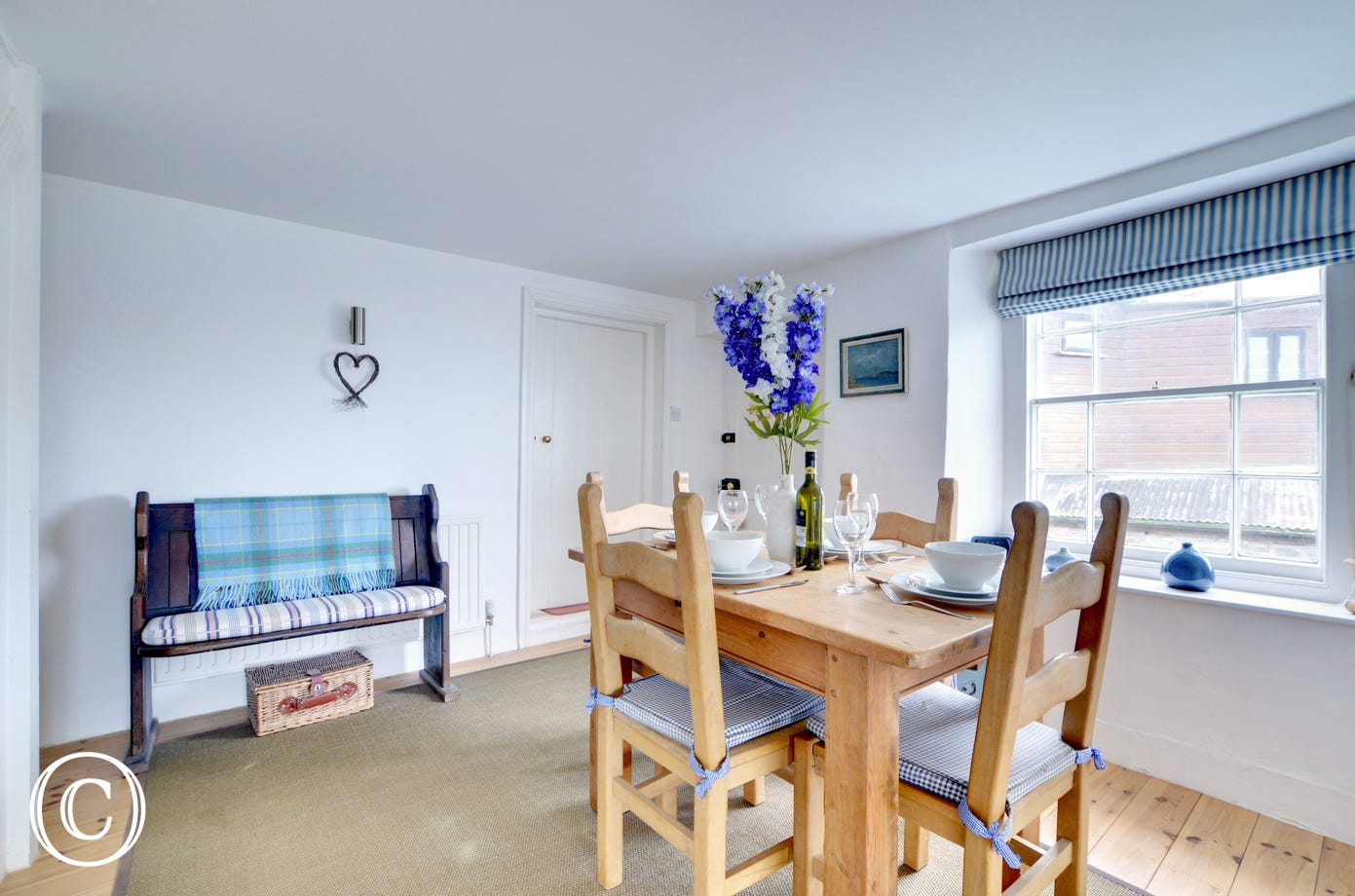 The separate dining room, also has lovely sea views and sounds of the nearby waterfall