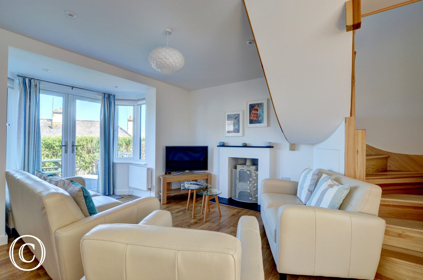 Views, comfortable leather sofas, woodburner!
