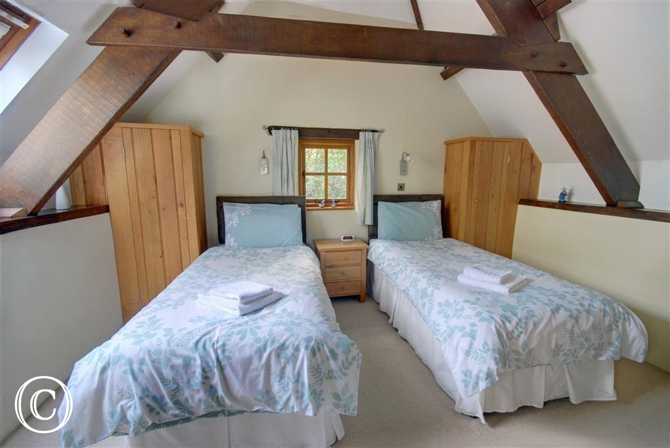 The twin bedroom has a built in oak wardrobe and a garden outlook.