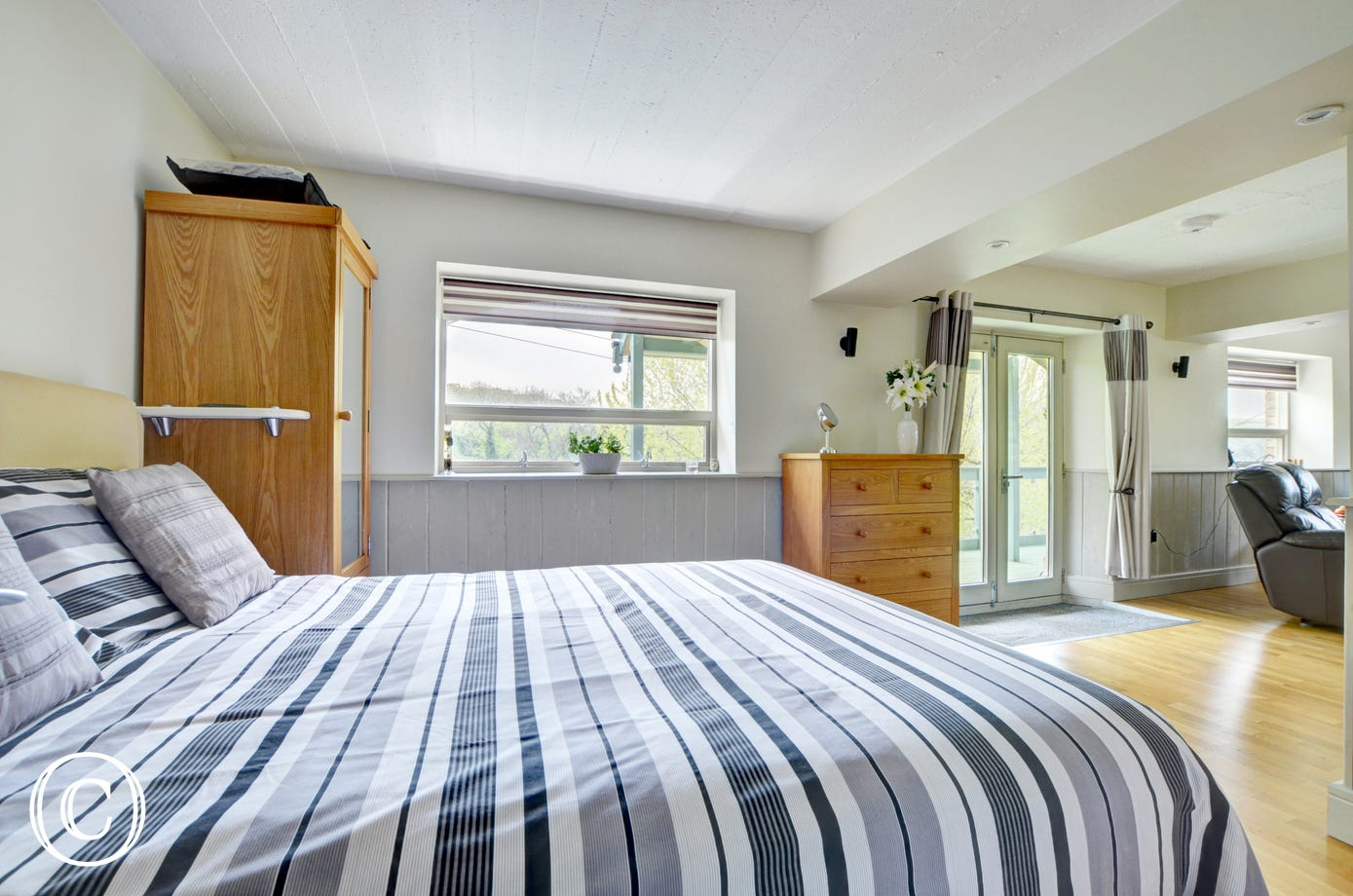 The bedroom area has a king size bed with luxury en suite shower room