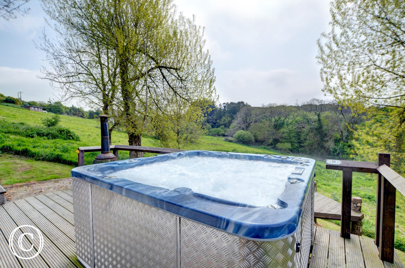 Relax in the hot tub at the end of the day and enjoy the stunning countryside views