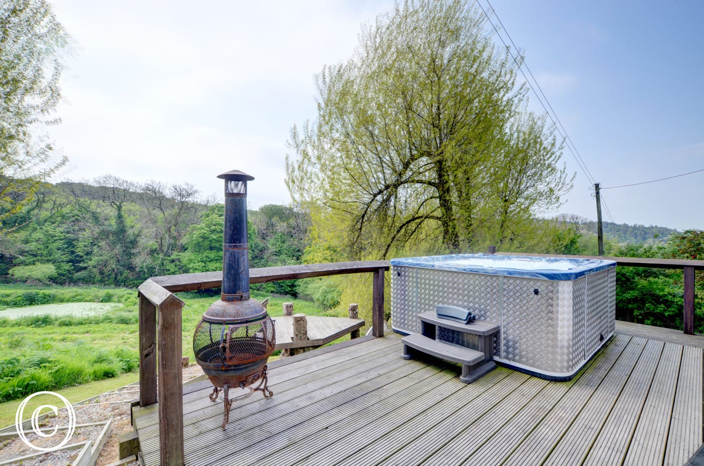 The hot tub area and outside log burner, and ideal way to relax at the end of the day