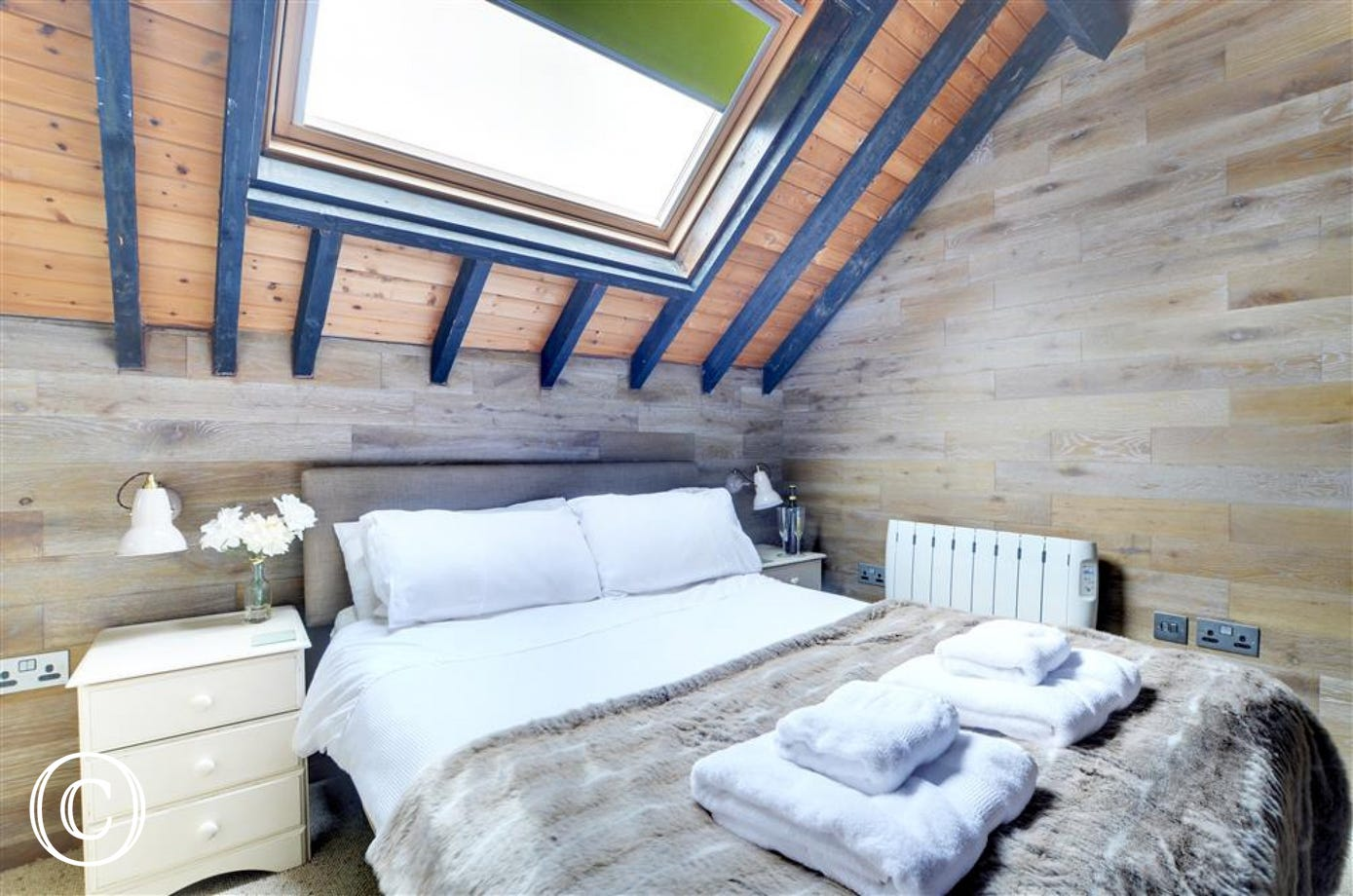 A unique double bedroom in the minstrels gallery with a high vaulted ceiling and overlooking the sitting room below.