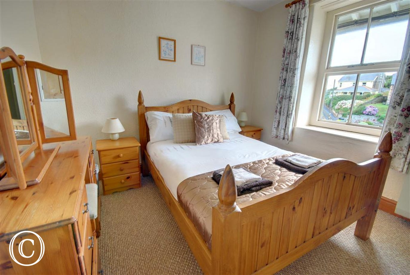 Double bedroom with matching pine furniture and views across the village and beyond
