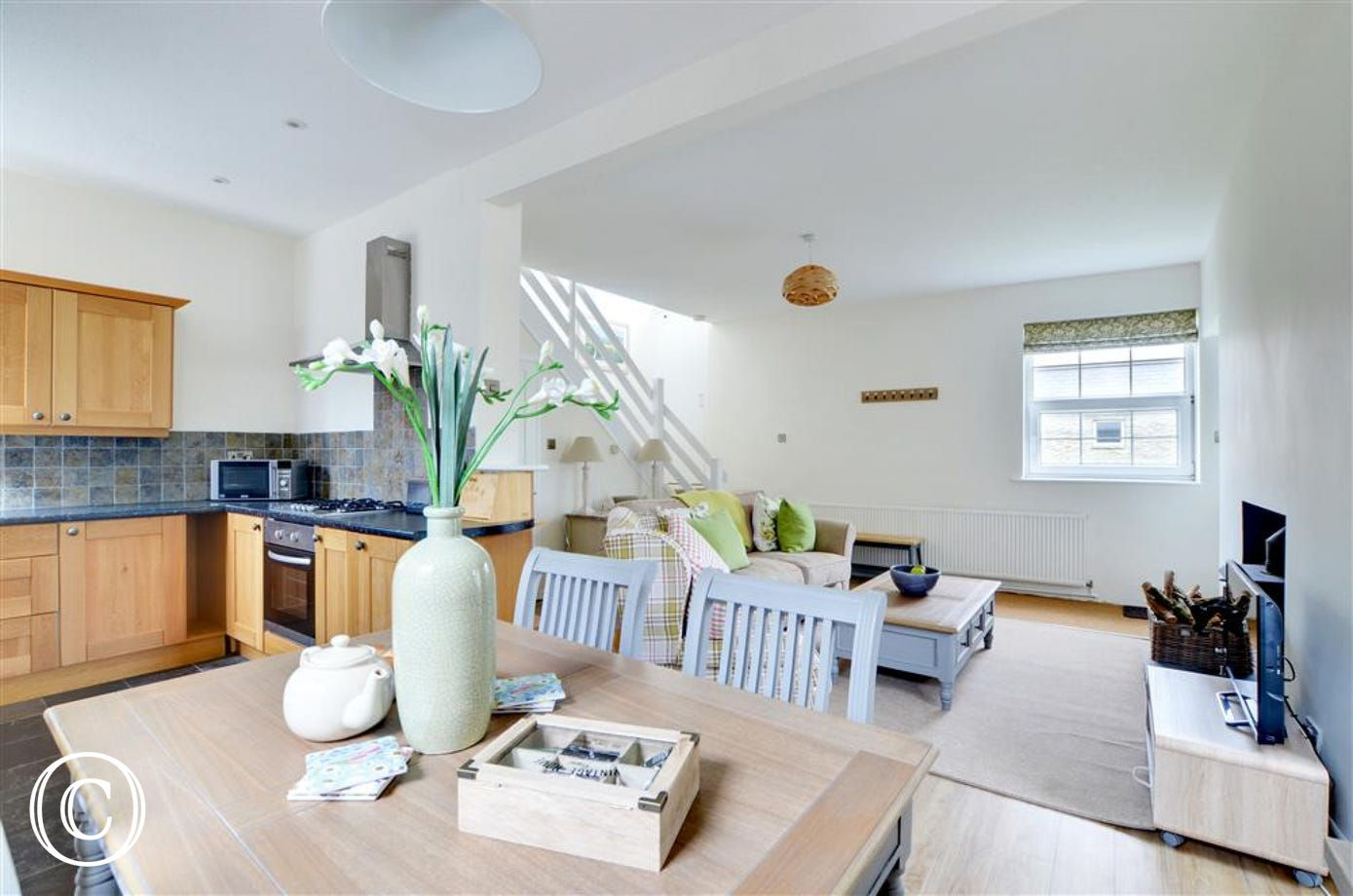 Spacious open plan dining area, kitchen and sitting room