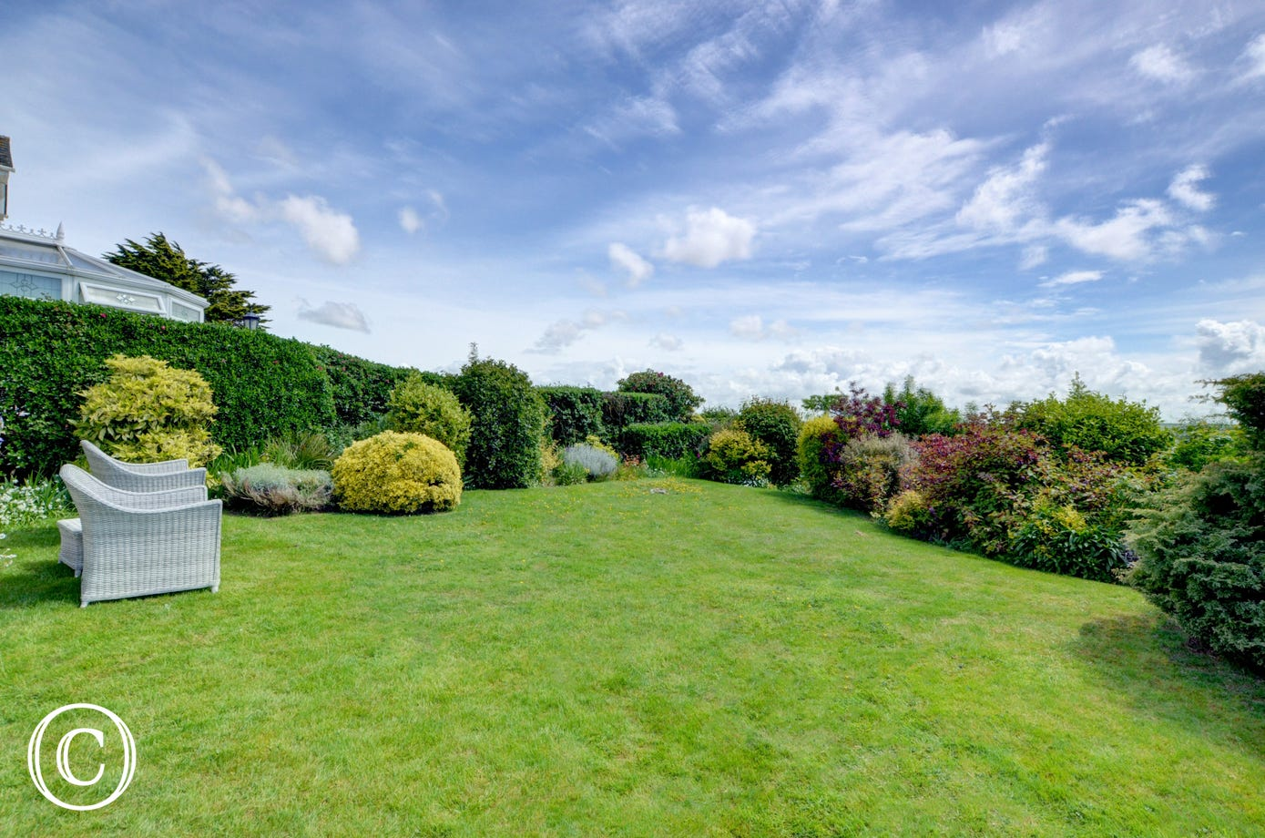 The beautiful gardens have mature shrubs and borders in addition to the lawns