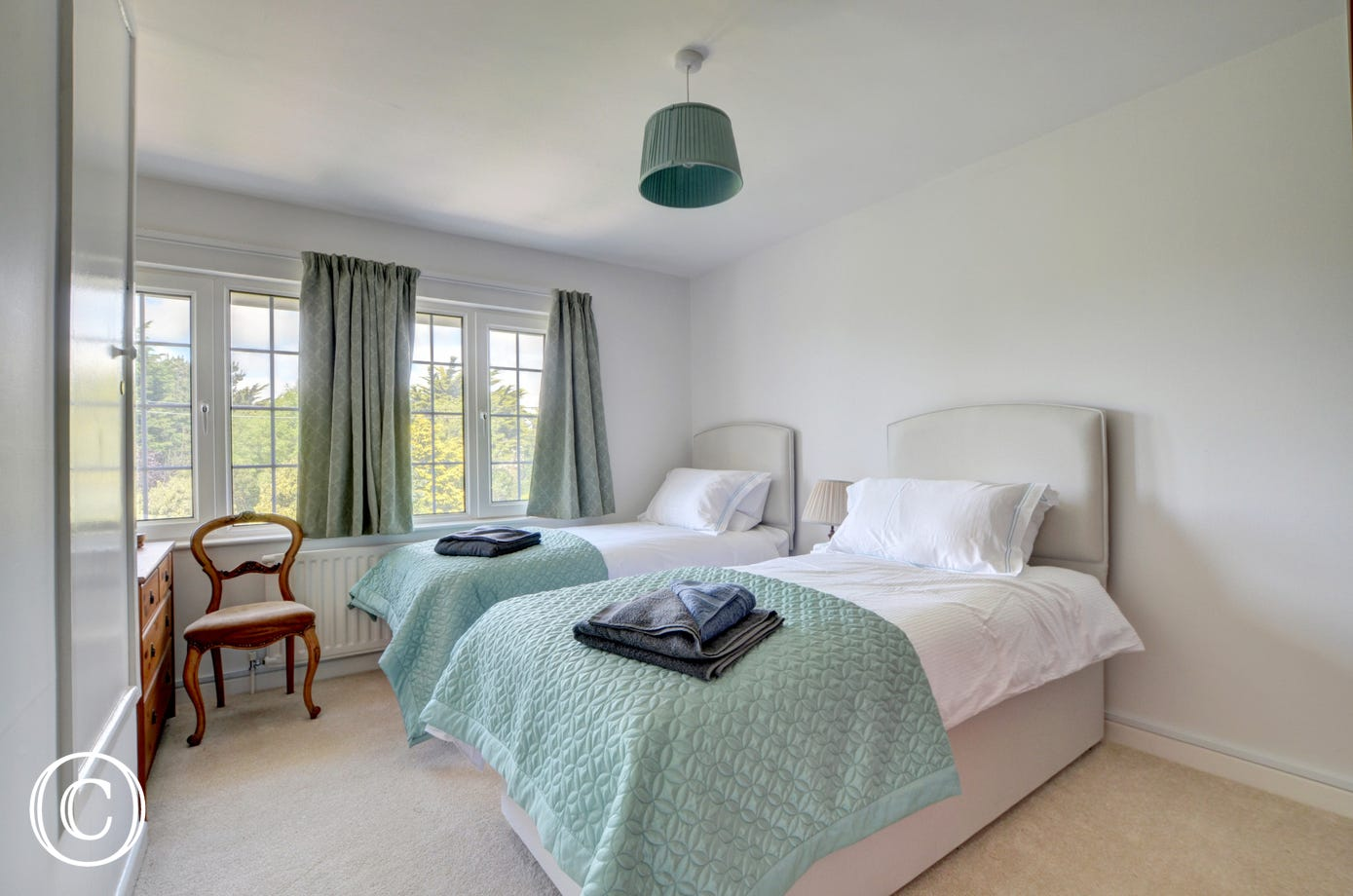 One of the spacious twin bedrooms