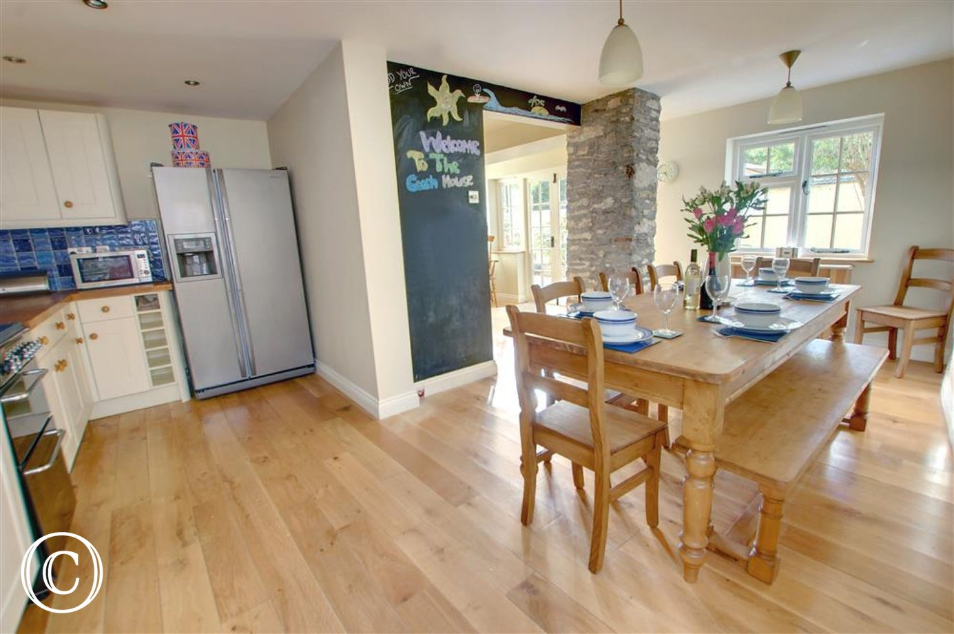 A spacious open plan well equipped kitchen includes an attractive dining area, ideal for enjoying meals with family and friends