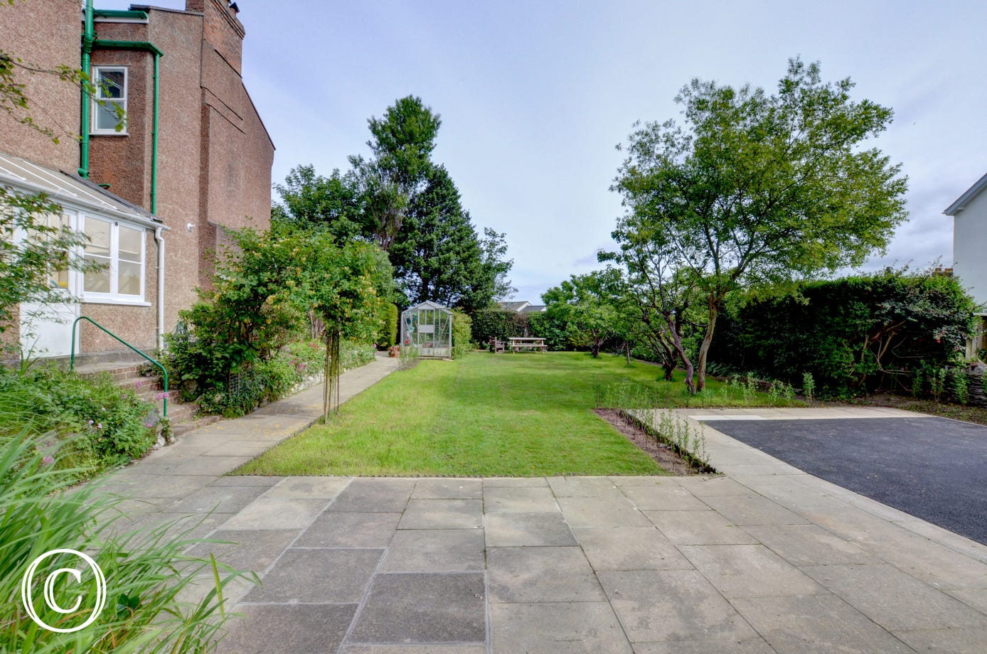 Spacious garden and parking area