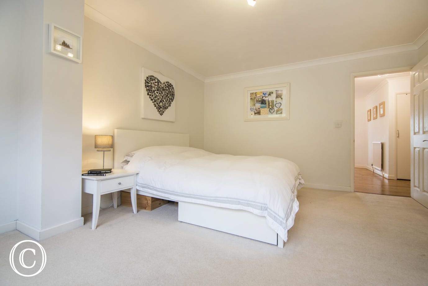Spacious master bedroom en-suite with a oversized sized king bed with wardrobes and large mirror.