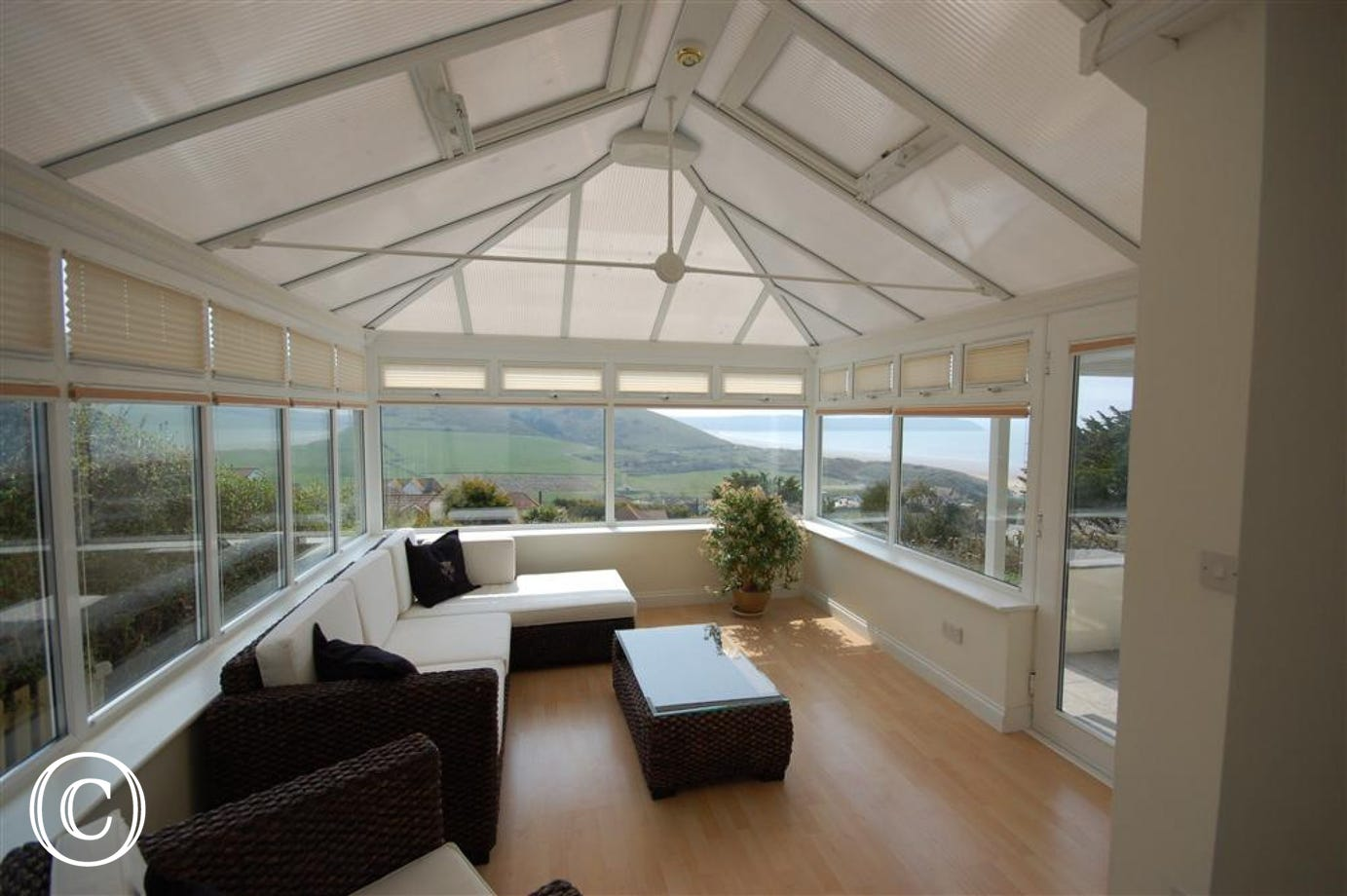 A beautiful conservatory, leading off one of the twin rooms, opens onto the mature landscaped gardens