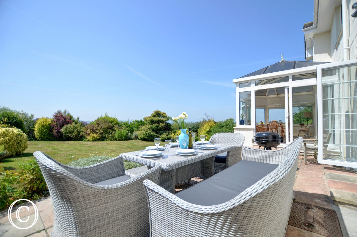 The patio has comfortable garden furniture to relax in whilst enjoying a BBQ
