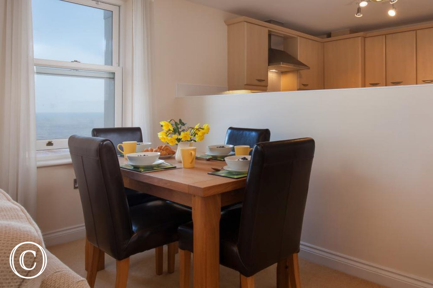 Modern Dining Area at 16 Great Cliff, a high-quality self-catering holiday apartment in Dawlish, South Devon