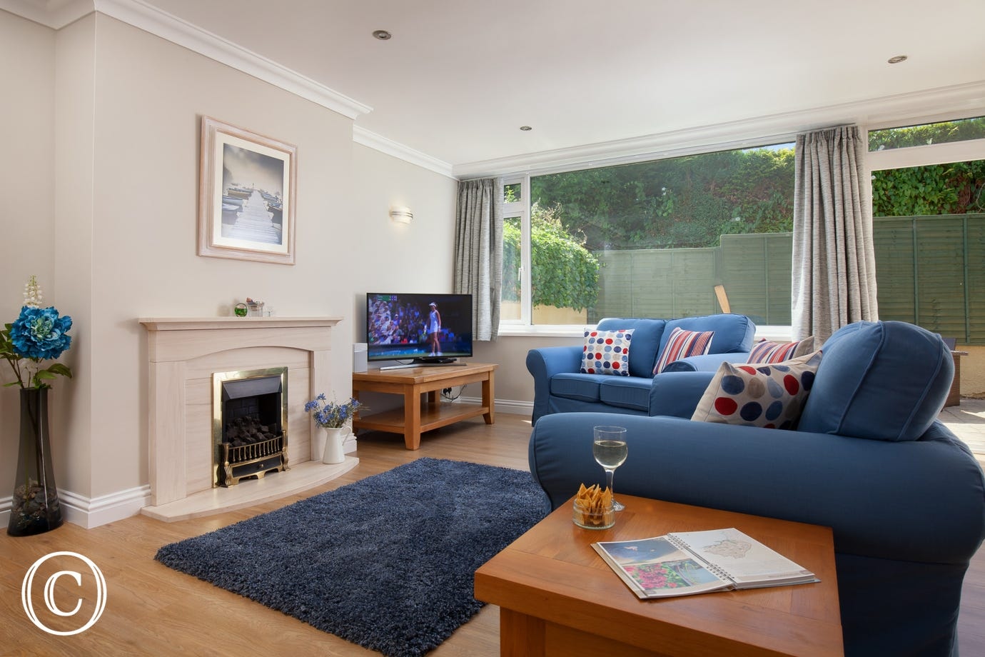 stylish living room with smart TV and blue sofas