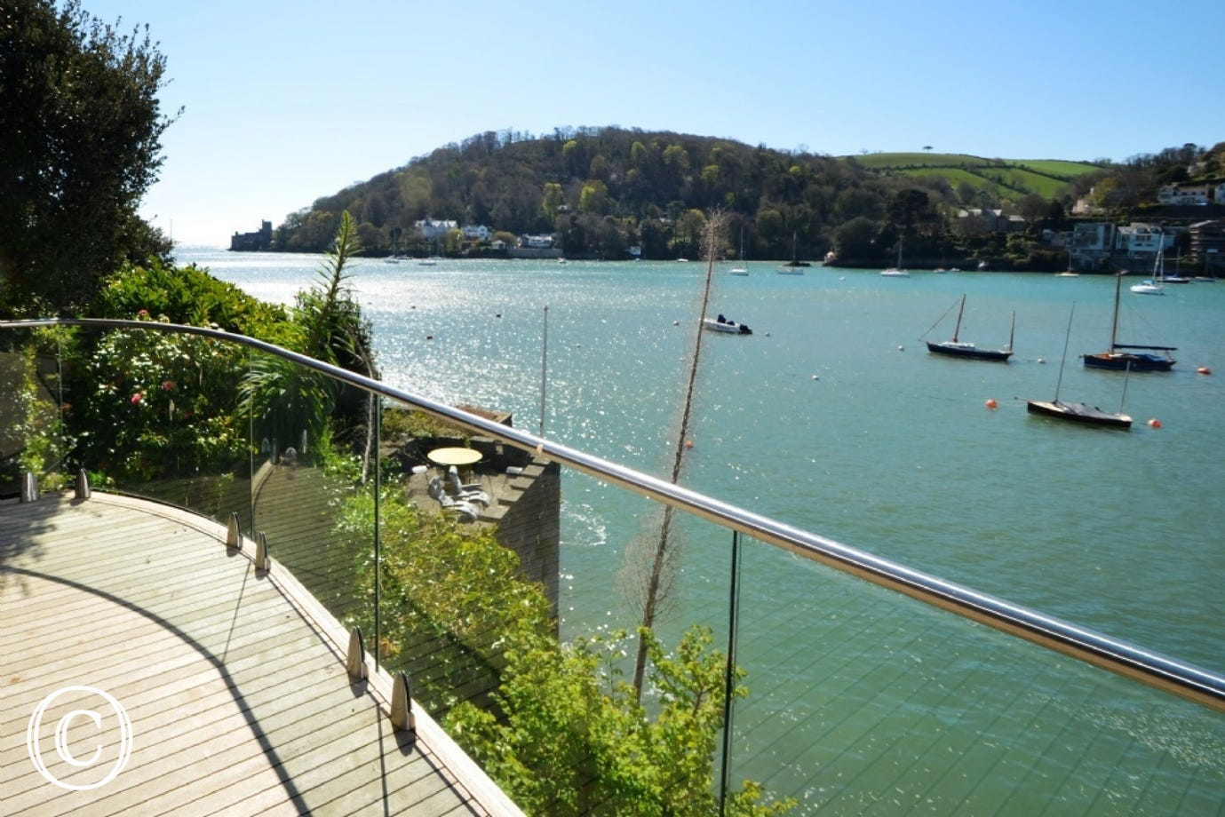This property has recently been individually designed and built with wooden decking and glass balconies offering exquisite views of the River Dart, Dartmouth Castle and the open sea , a fantastic space for those al-fresco moments.