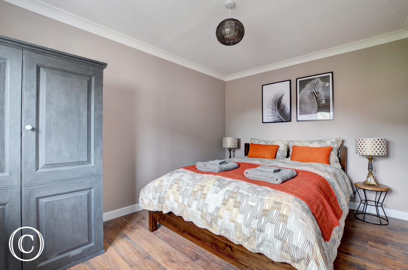 The double bedroom with kingsize bed has been beautiful decorated with stylish furnishings