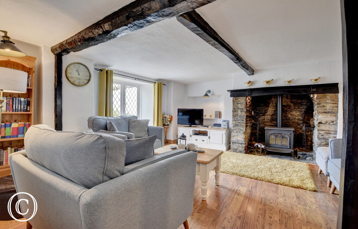 Comfortable seating and a lovely fire place in the sitting room