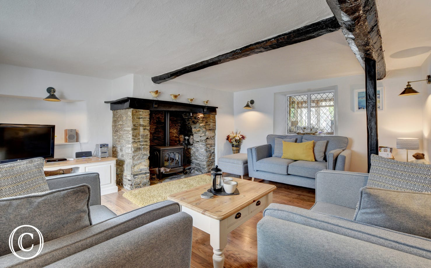 The inglenook fireplace, complete with bread oven and gas coal burning effect stove in the living room will keep you cosy on cooler evenings
