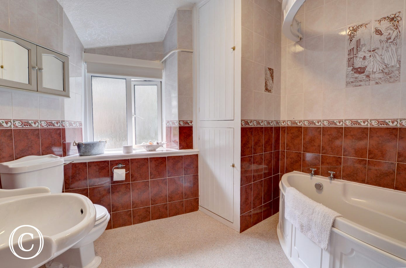 A large bathroom with corner bath and electric shower completes the accommodation