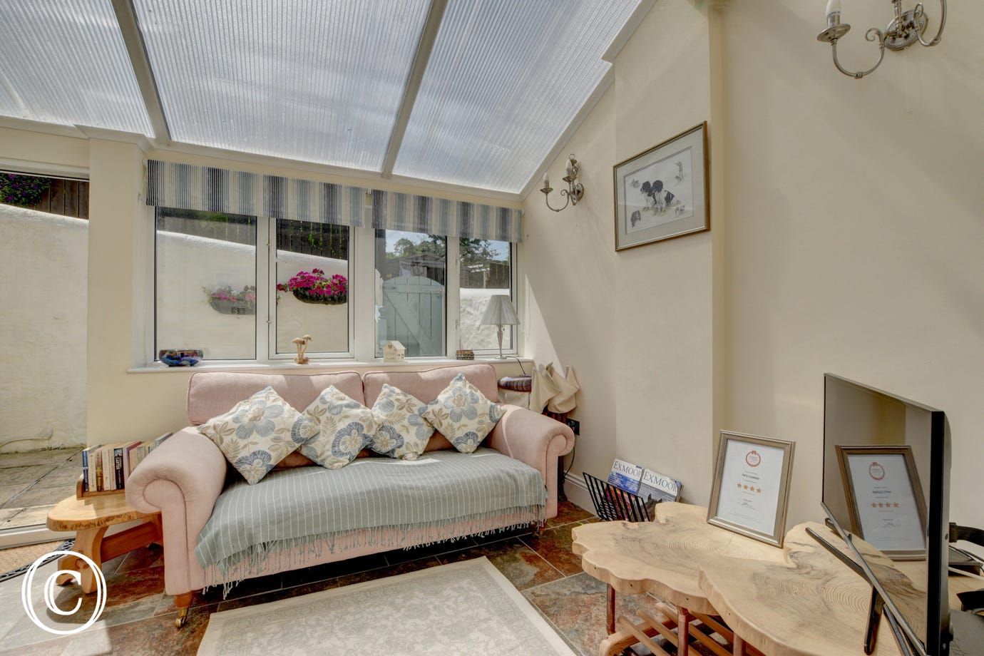 This lovely conservatory offers extra seating and another TV