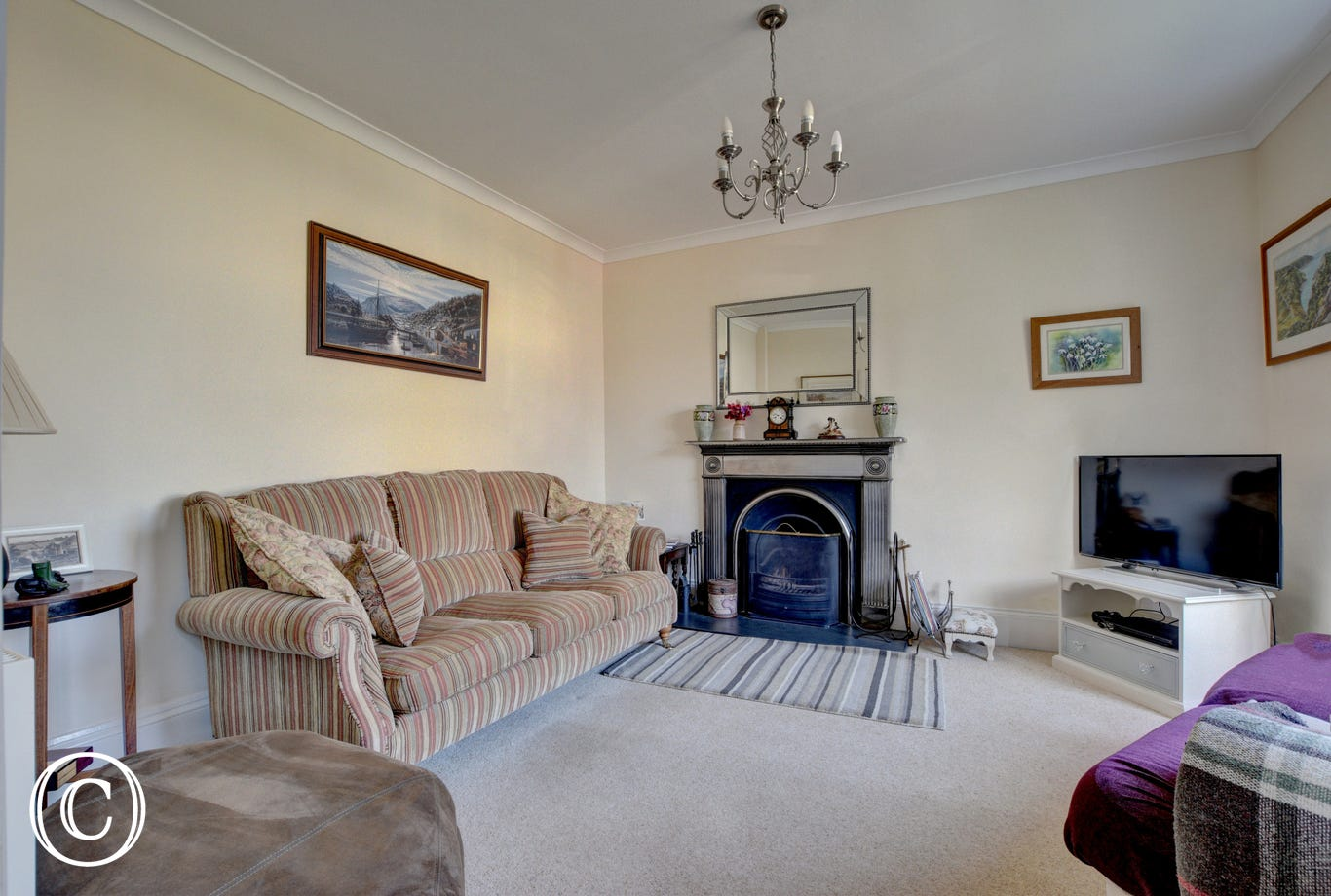 Comfortable sitting room with wonderful open fire