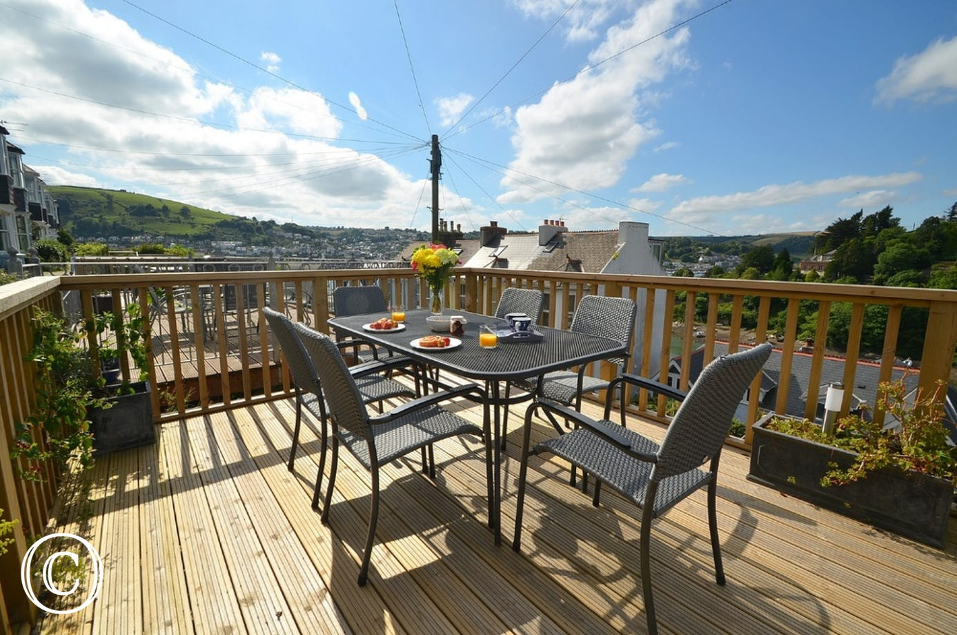 Outside: Small seating area to the front of the property with views over the river and Dartmouth.