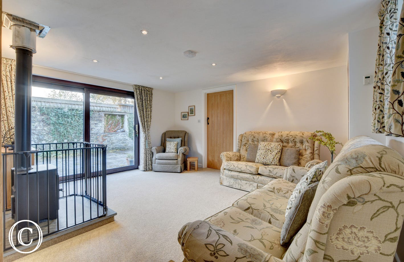 The barn has a lovely open plan living room with patio doors leading onto a large and fully enclosed sun trap courtyard