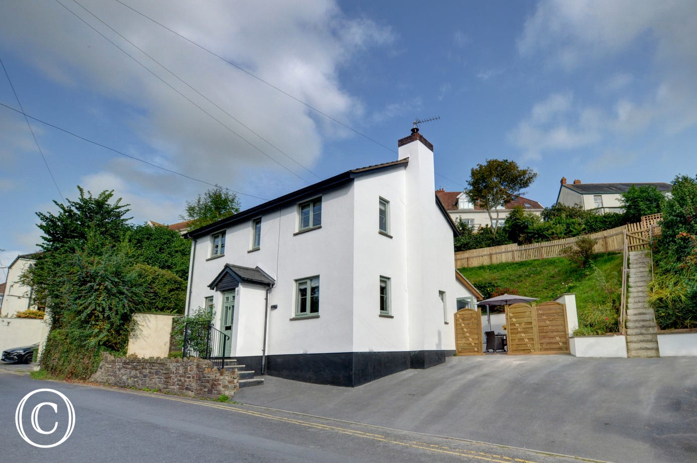 Situated just a short stroll from the village centre of Braunton this recently renovated property also has private parking for 3 cars