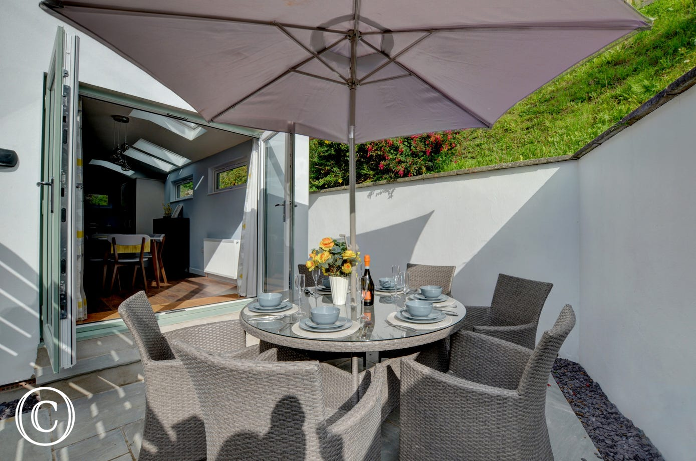 The kitchen has patio doors that lead onto a private patio area, ideal for al fresco dining
