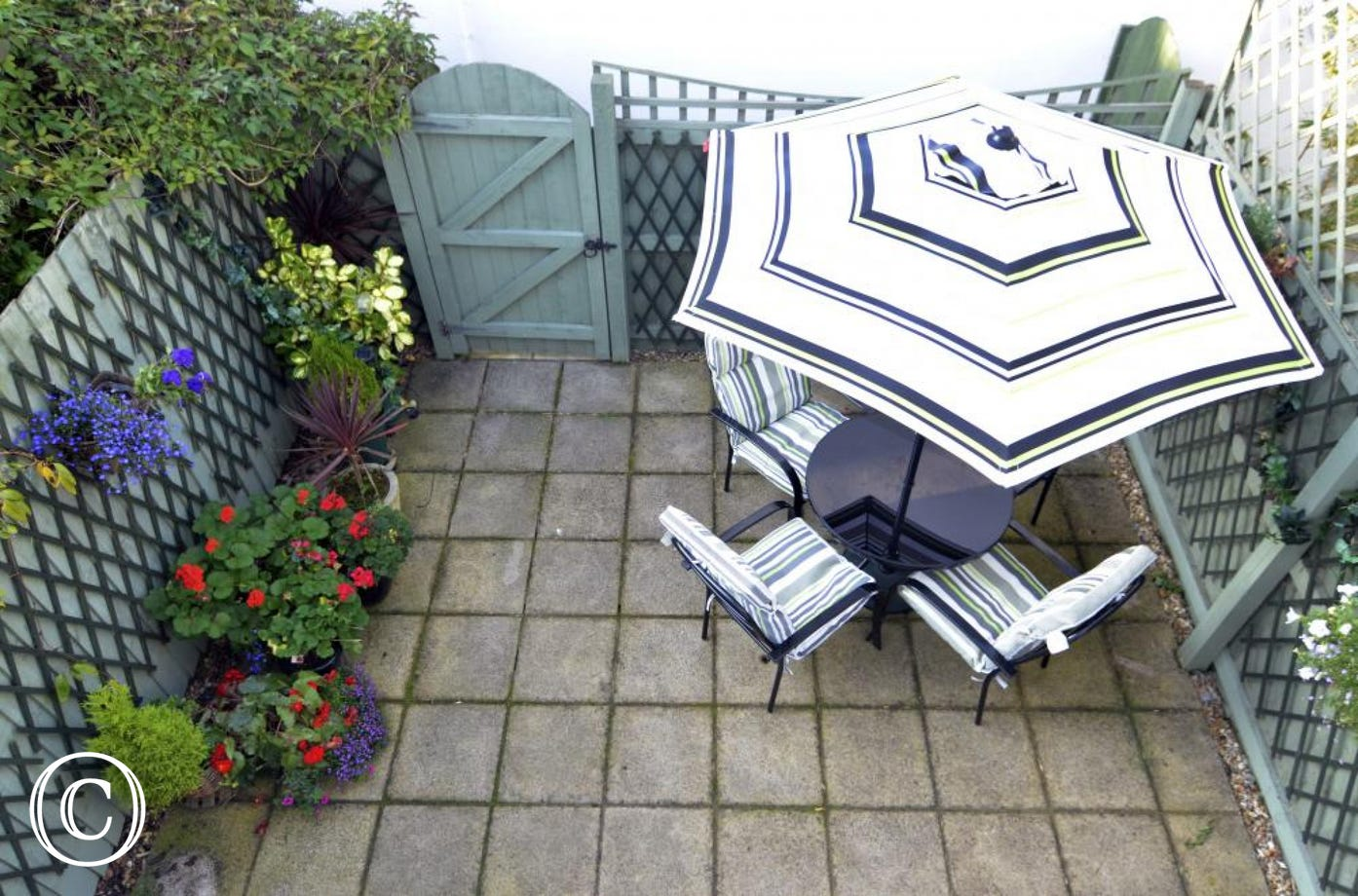 Relax in the Sun on the Courtyard to the Rear of this Beach Retreat Mews Holiday Home in Sunny Torquay in Torbay, South Devon