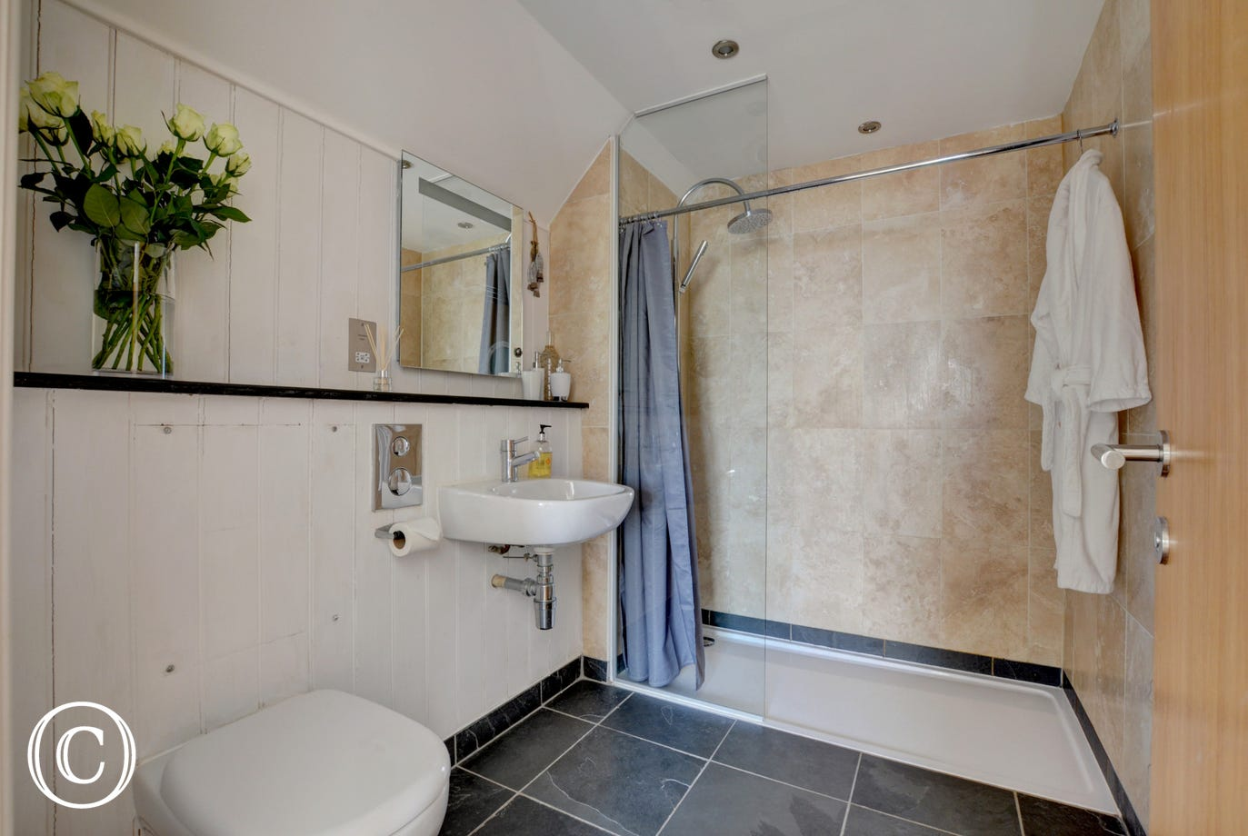 The stylish ensuite with huge walk in shower
