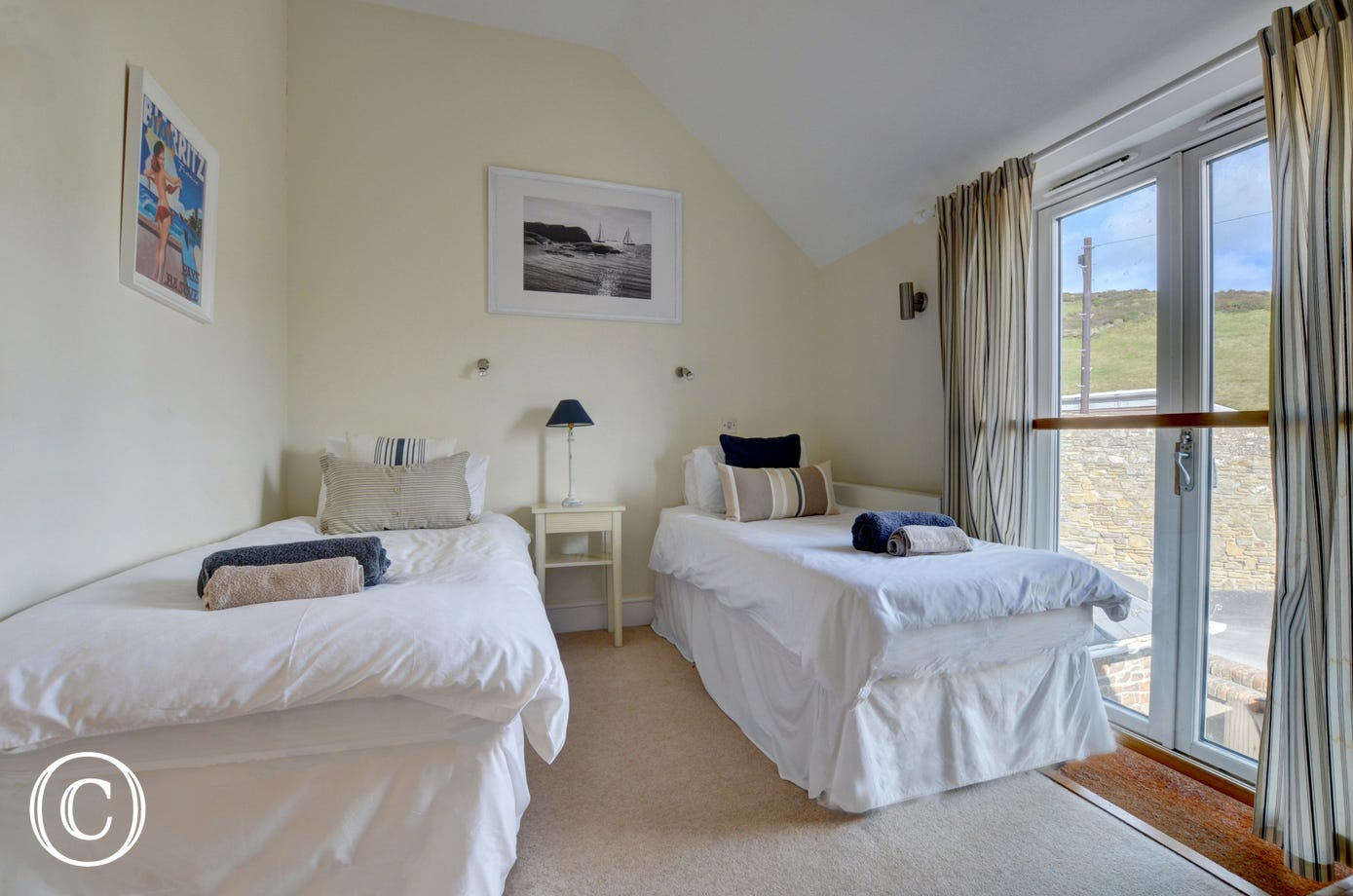 The second bedroom overlooks National Trust countryside and is served by a modern family bathroom