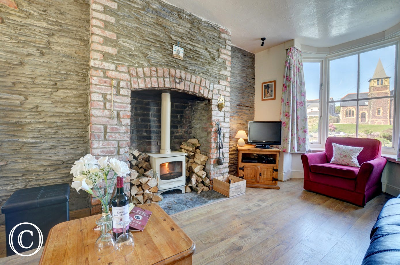 The woodburner makes the sitting room extremely cosy on cooler evenings