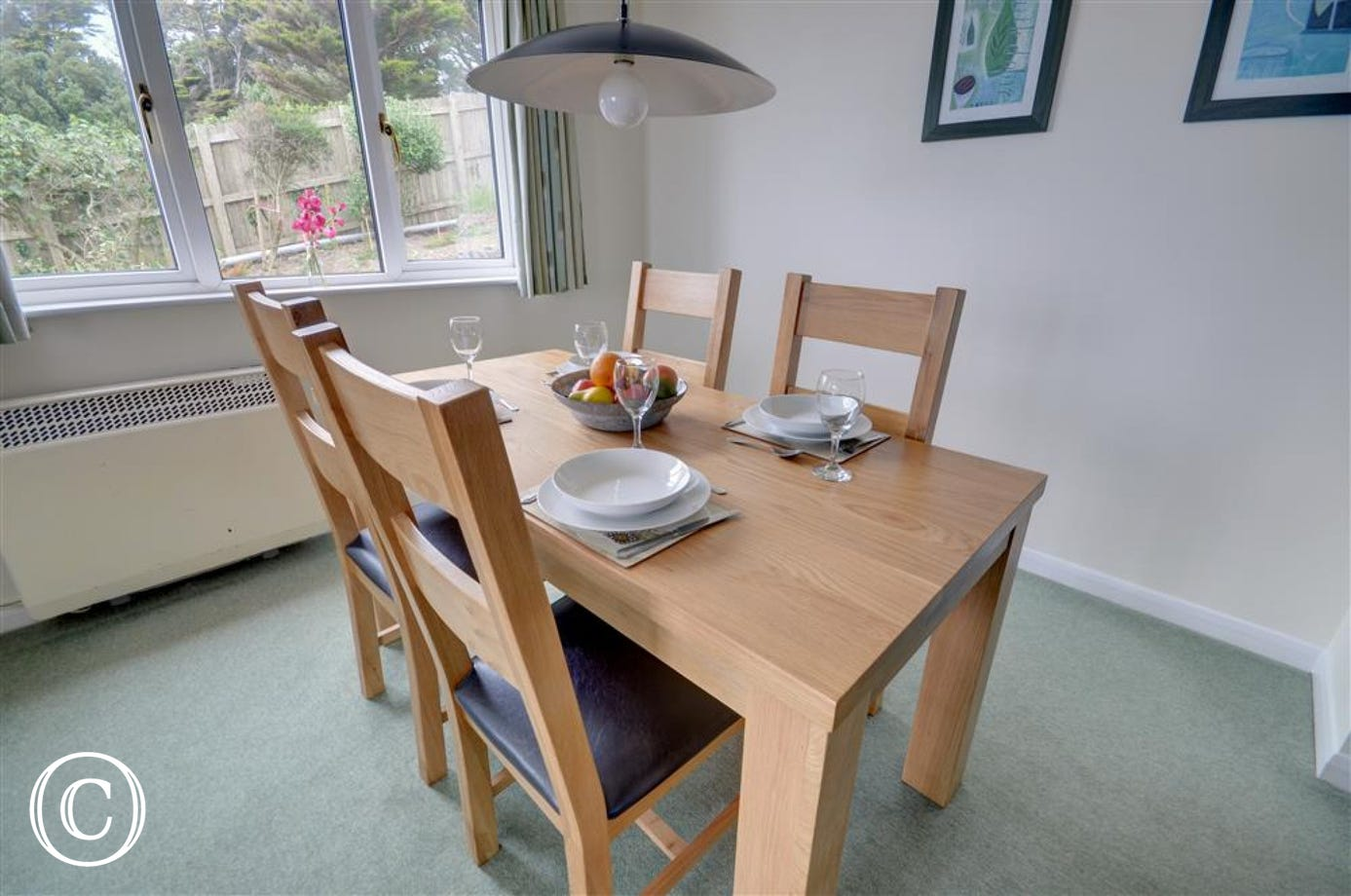 This dining area has folding doors into the sitting room and an arch way to the kitchen