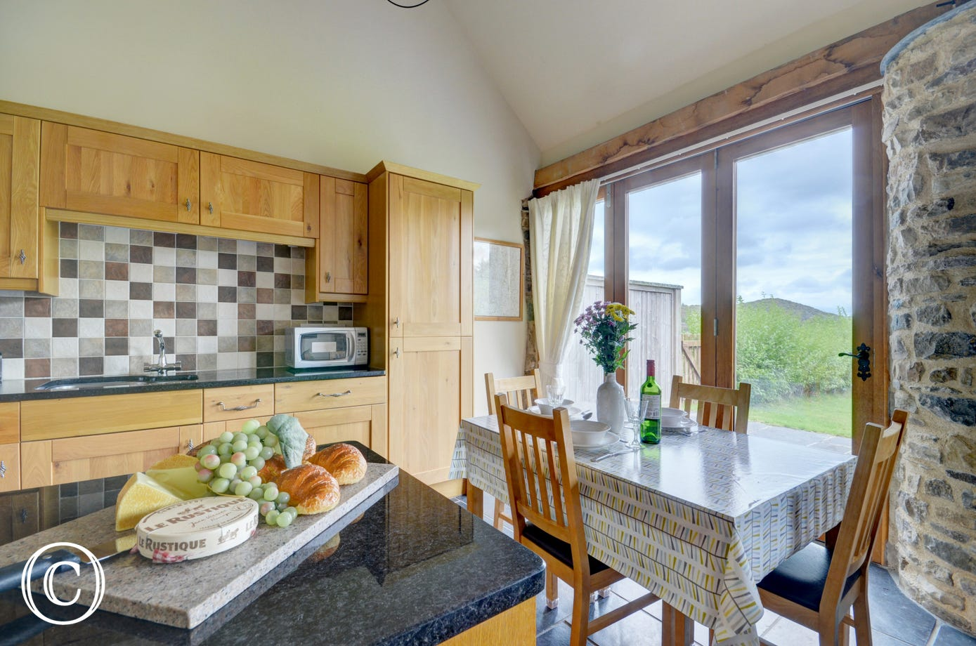 The well equipped kitchen and dining area with wonderful views